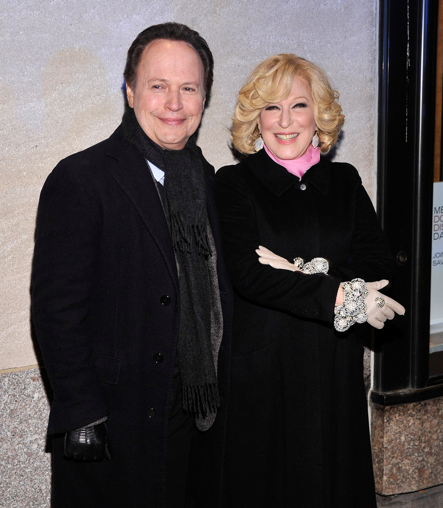 Actor Billy Crystal and Bette Midler at the 80th Annual Rockefeller Center Christmas Tree Lighting Ceremony on November 28, 2