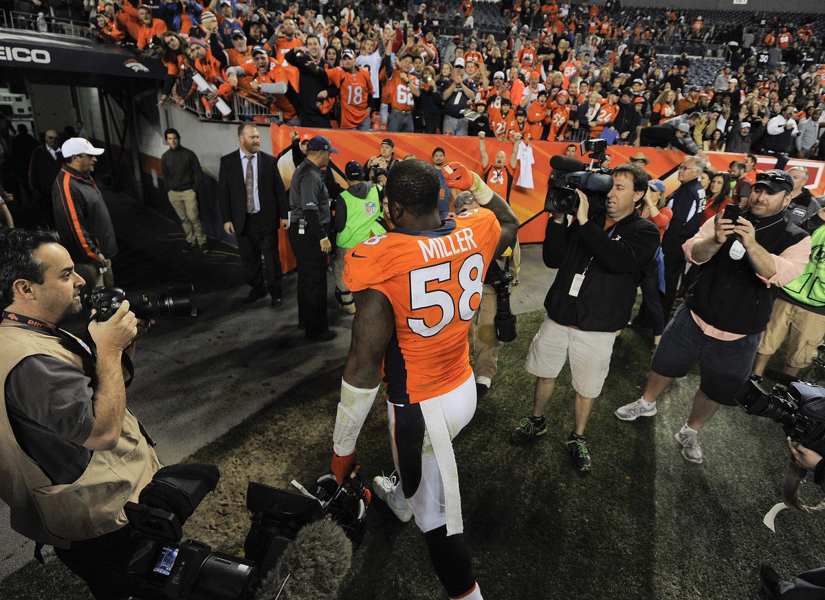 Denver Broncos outside linebacker Von Miller (58) pumps his fist as he leaves the field after playing against the Tampa Bay B