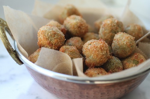 "<strong>Get the <a href=""http://www.aliyaleekong.com/harissa-cheese-stuffed-fried-olives/"">Harissa-Cheese Stuffed Fried Olive"