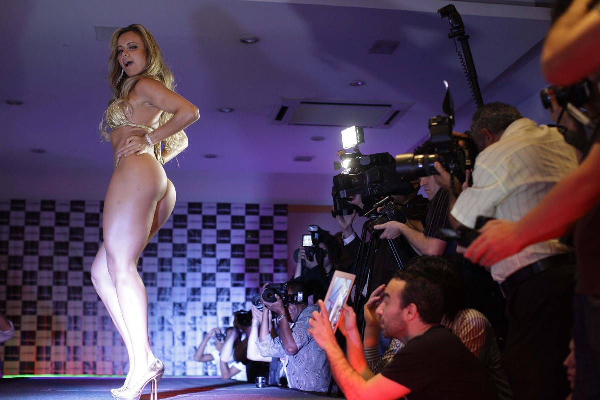 Cibelle Ribeiro competes in the Miss Bumbum Brazil contest as photographers take pictures in Sao Paulo, Brazil, Friday, Nov.