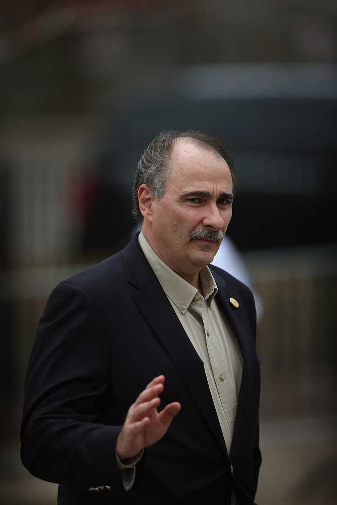 David Axelrod, senior campaign advisor for U.S. President Barack Obama, waves to people gathered near the Martin Luther King