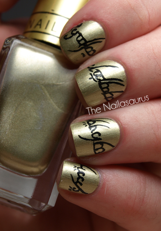 "This gold and black ""Lord Of The Rings"" manicure is geek art at its finest. Get excited for ""The Hobbit"" with a stylish remin"
