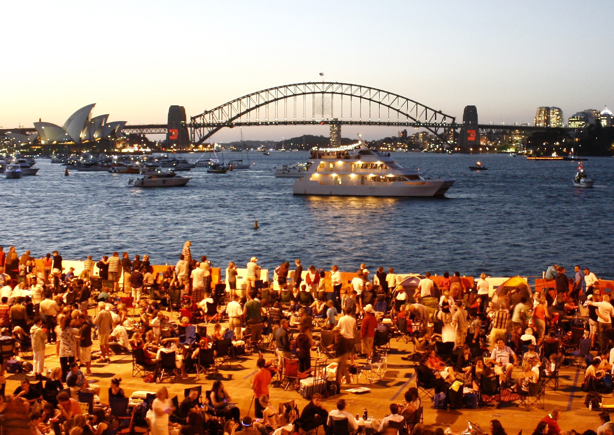 Crowds gather at the naval base on Gargen Island in anticipation of the annual New Year's Eve fireworks display over Sydney H