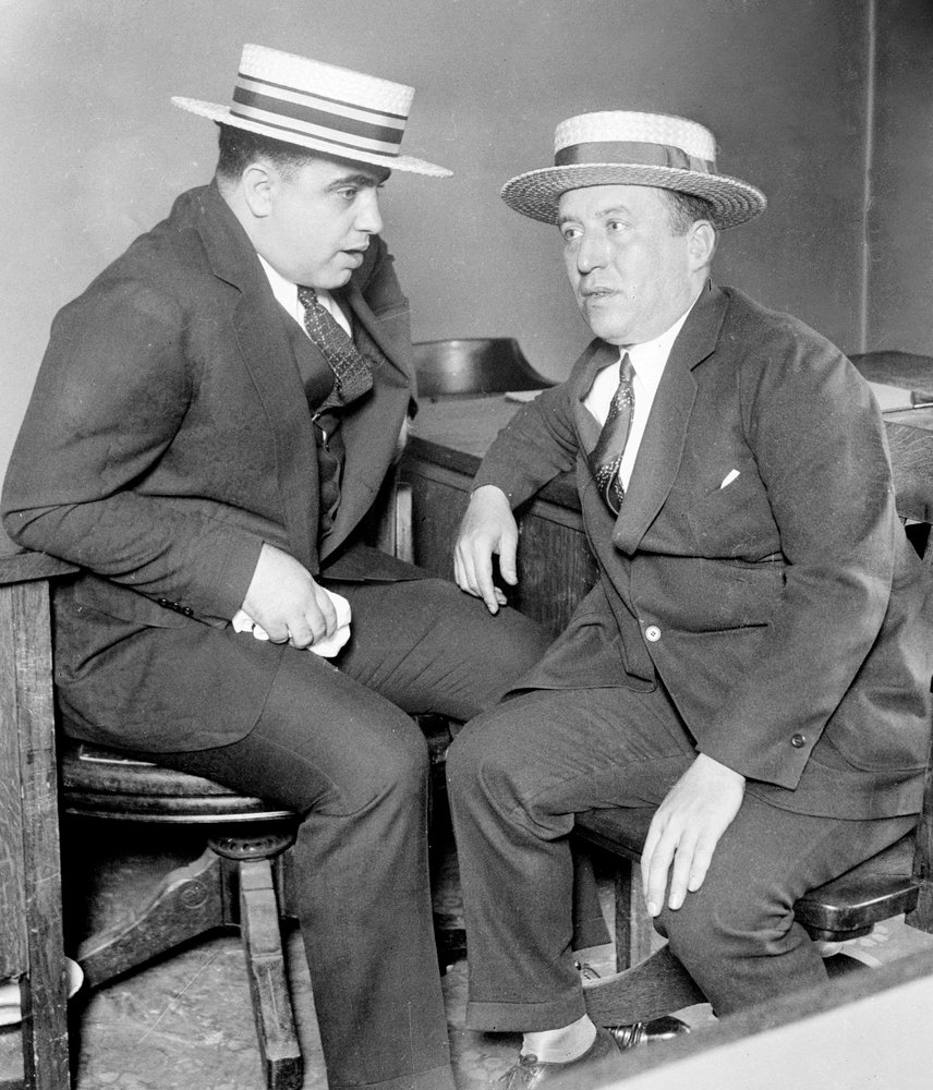 Al Capone (left) moved to the Windy City in 1919. When Torrio fled Chicago in 1925, Capone took over and expanded operations,