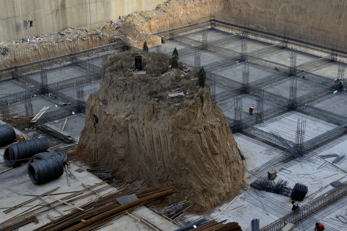 An isolated tomb is left standing in the middle of a construction site on Dec. 6, 2012 in Taiyuan, China. The tomb is an ance
