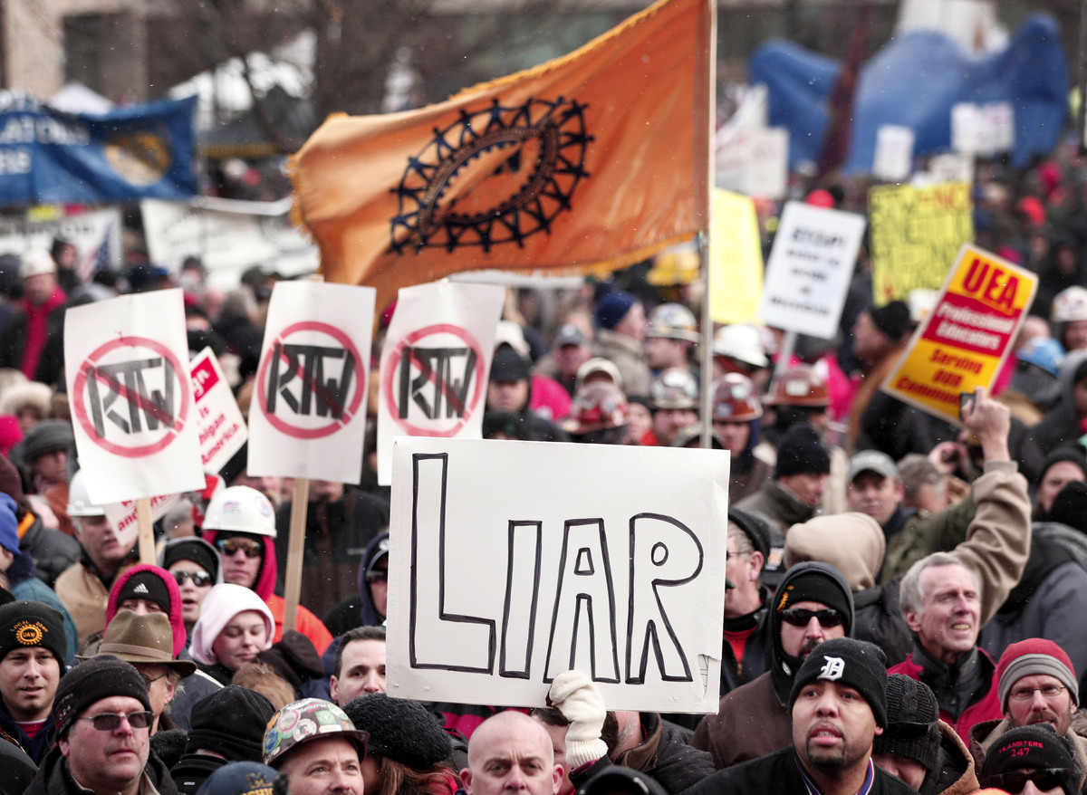 LANSING, MI, - DECEMBER 11: Union members from around the country rally at the Michigan State Capitol to protest a vote on Ri