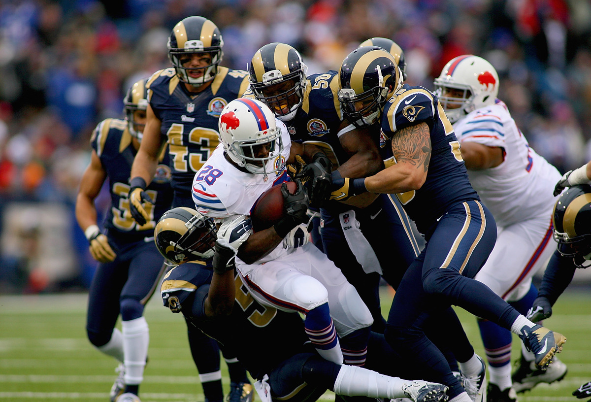 C.J. Spiller #28 of the Buffalo Bills is tackled by the St. Louis Rams at Ralph Wilson Stadium on December 9, 2012 in Orchard