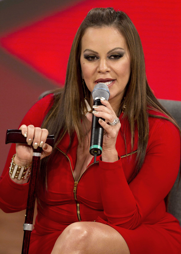 FILE - In this Aug. 21, 2012, file photo, singer and singing coach Jenni Rivera speaks during a press conference promoting th