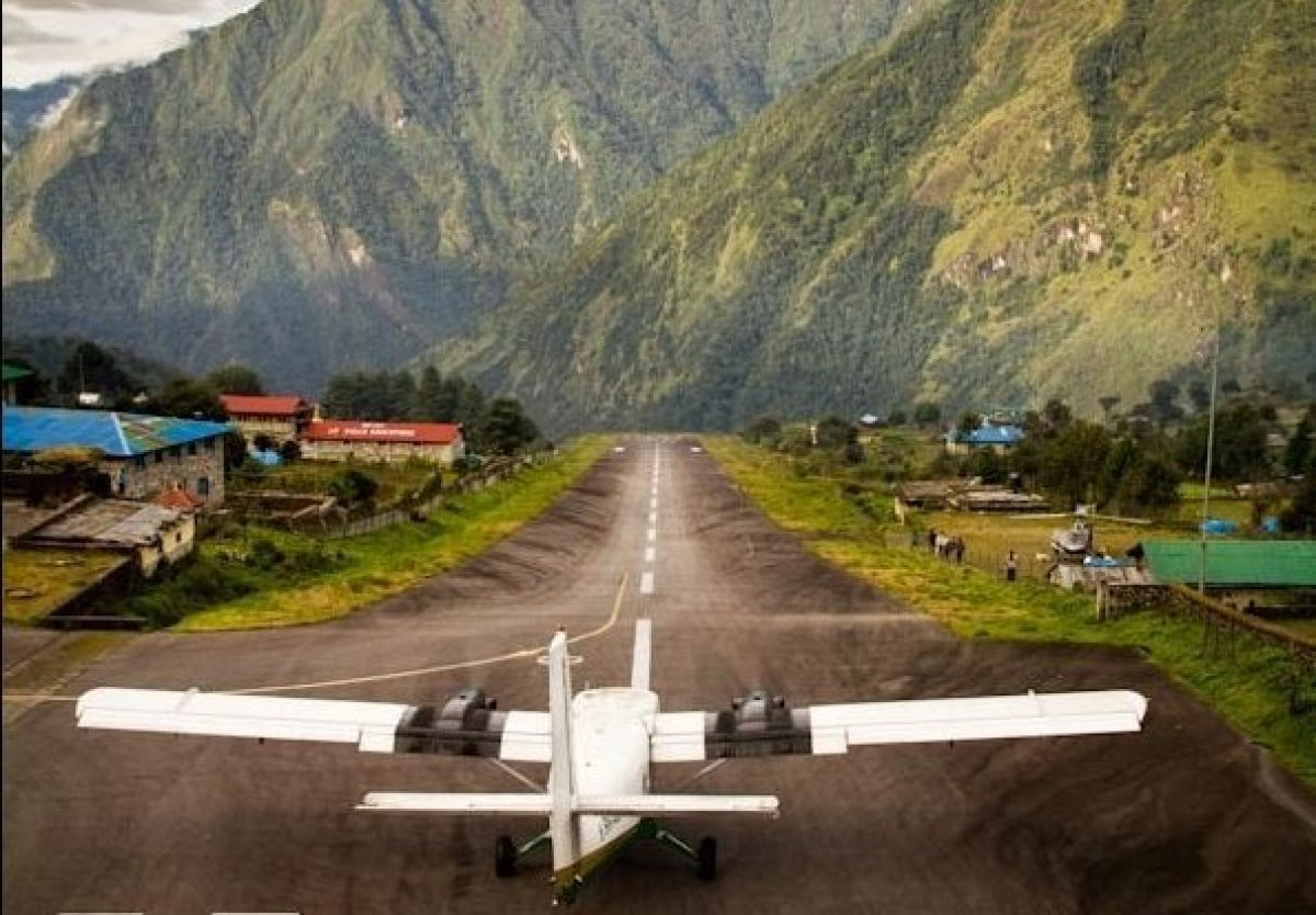 A twin-prop plane readies for take-off at Lukla's Tenzig Norgay Airport, known as the world's most dangerous.