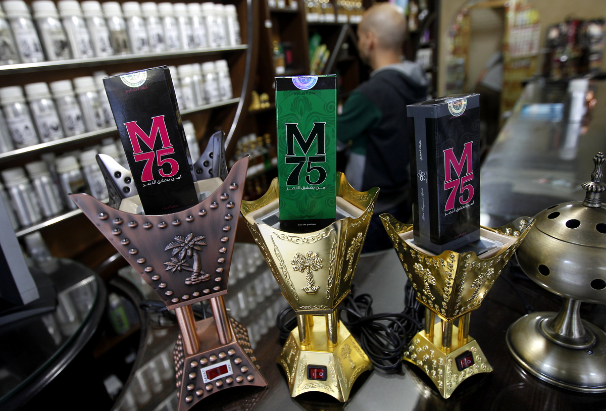 Packaged M75 perfume bottles are displayed at the 'Stay Stylish' shop in Gaza City on Dec. 10, 2012. 'Victory' has never smel