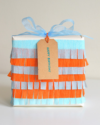 "<a href=""http://www.willowday.com/2012/04/gift-wrap-series-13-fringe-for-bakers.html"">Willow Day's</a> crepe paper fringe can"