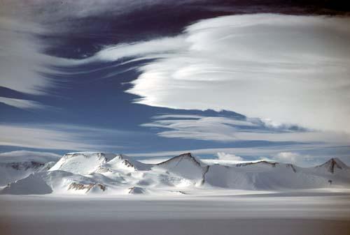 Lenticular clouds play over Evans Butte, Leverett Glacier area, Antarctica.
