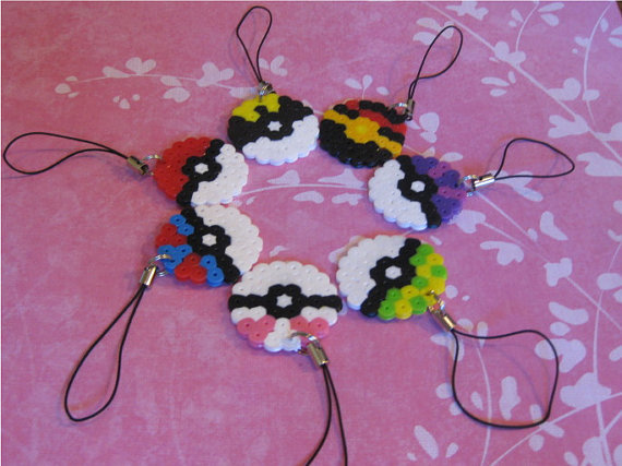 """These retro <a href=""""http://www.etsy.com/listing/76786220/wheres-your-pokeball"""">Pokeball charms</a> are the perfect affordabl"""