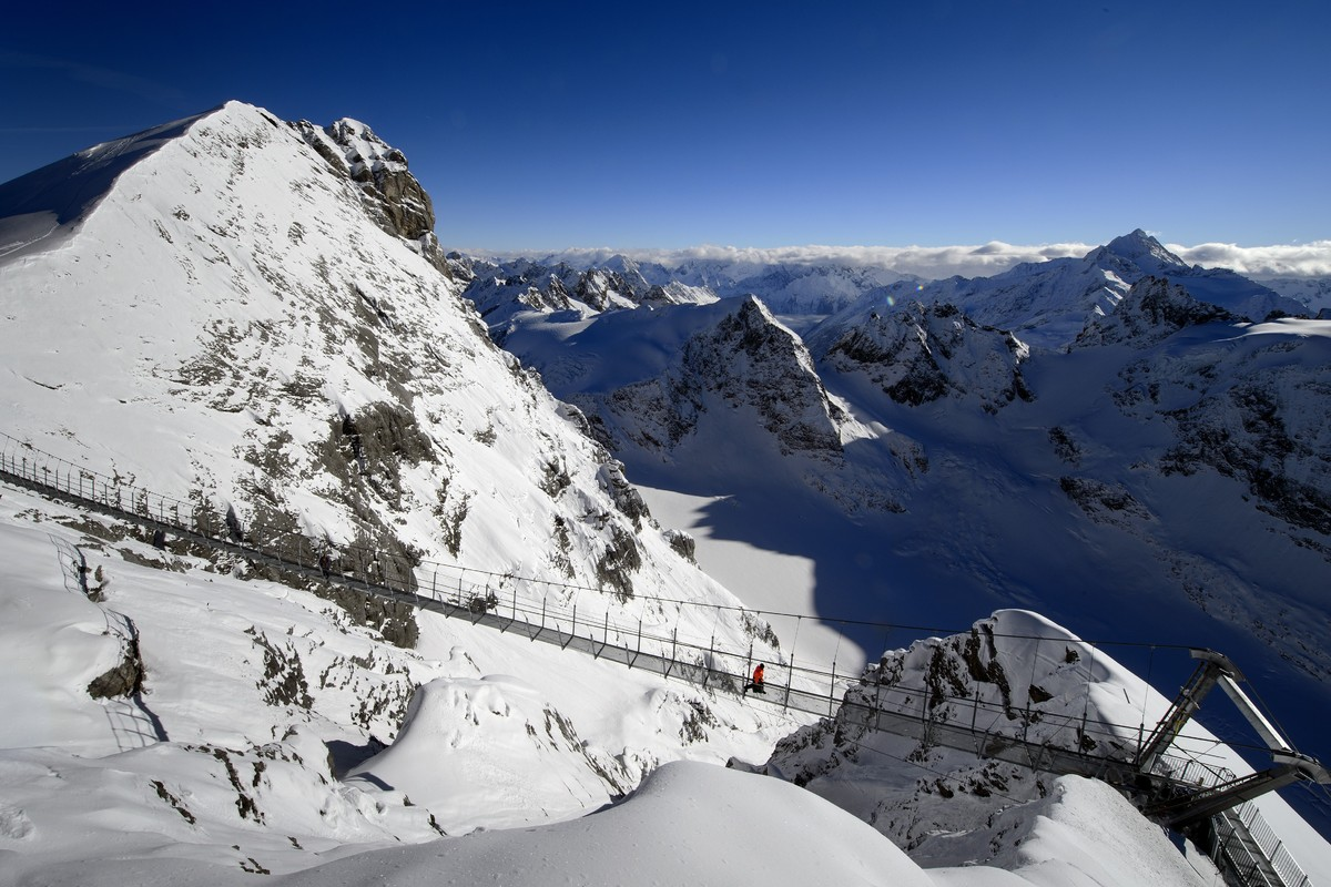 A worker walks on the highest suspension bridge in Europe on December 1, 2012 in the Titlis mountain above Engelberg, Central
