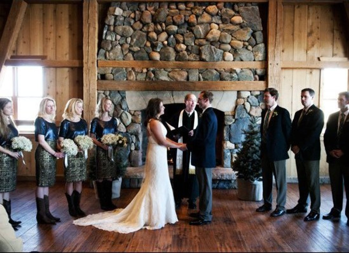 A cozy ceremony in front of a gorgeous stone fireplace.