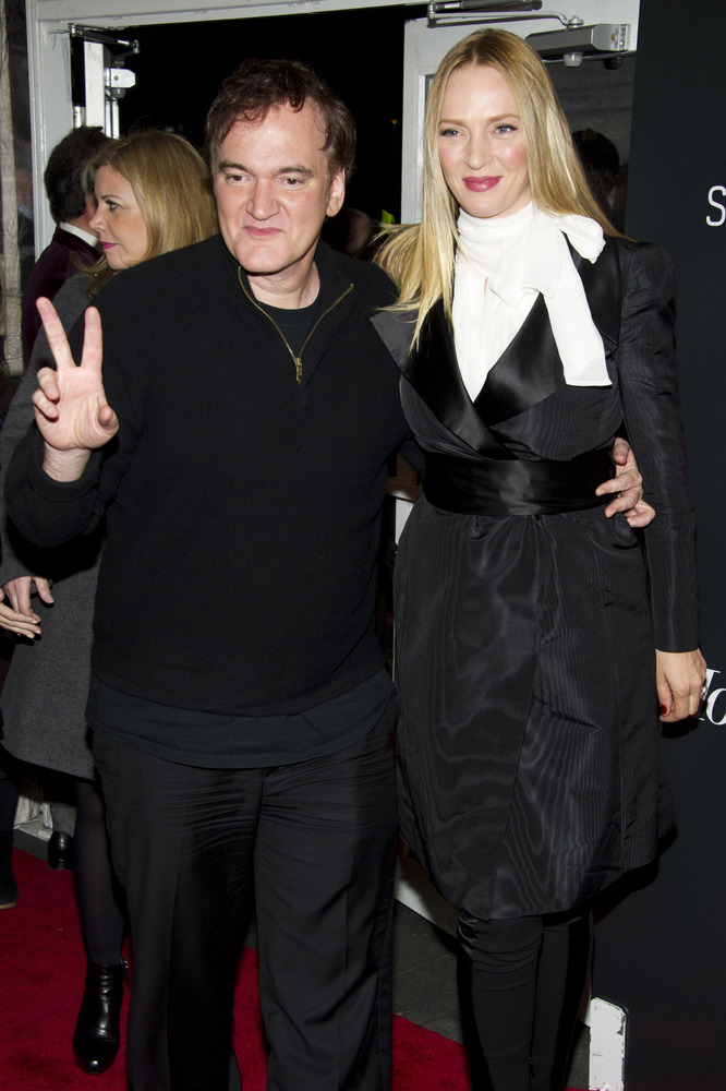 "Quentin Tarantino, left, and Uma Thurman attend the premiere of ""Django Unchained"" on Tuesday, Dec. 11, 2012 in New York. (Ph"