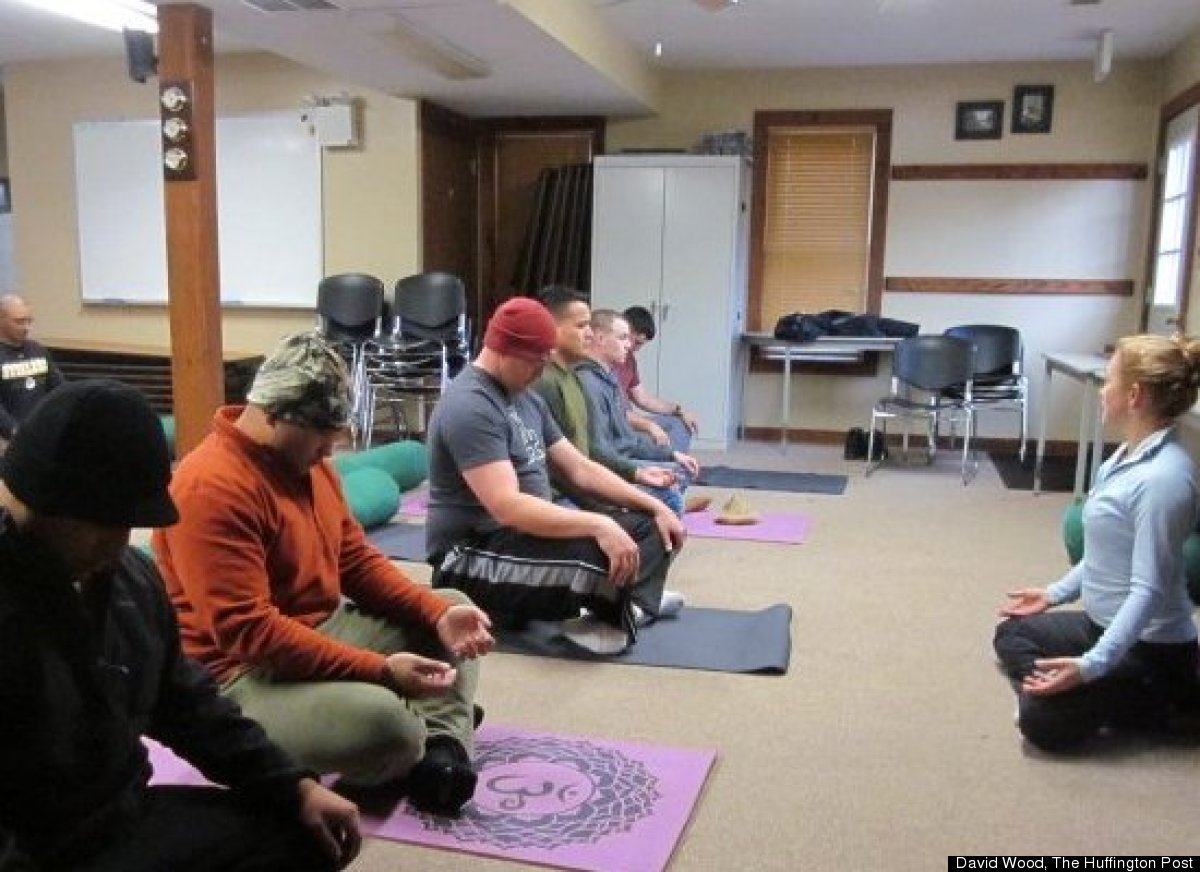 At a retreat for retiring Marines with combat wounds and PTSD, yoga teacher Annie Okerlin helps them work through pain, stiff