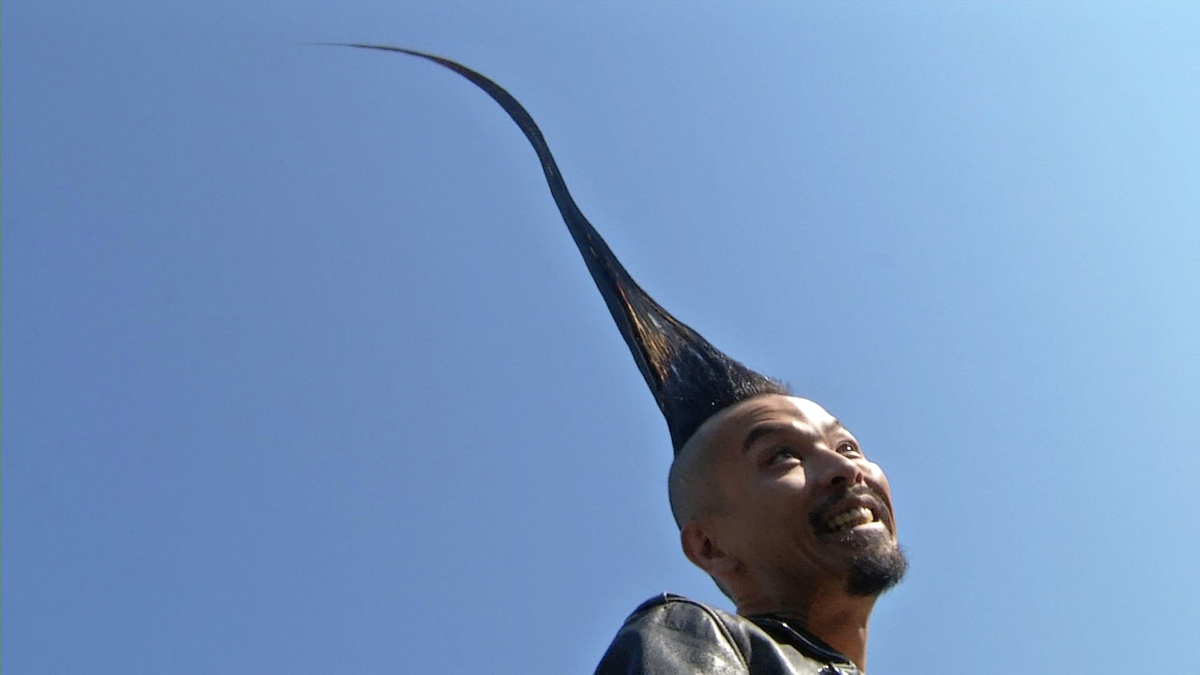 In this image taken from video, Kazuhiro Watanabe, 40, a fashion designer from Tokyo, shows off his 3-foot-8-point-6-inch hai