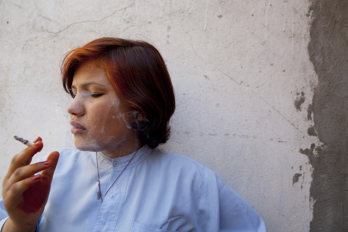 Shawal Jamila,19, smokes a cigarette inside the women's prison October 22, 2010 in Mazar-e-Sharif, Afghanistan. Accused of ba