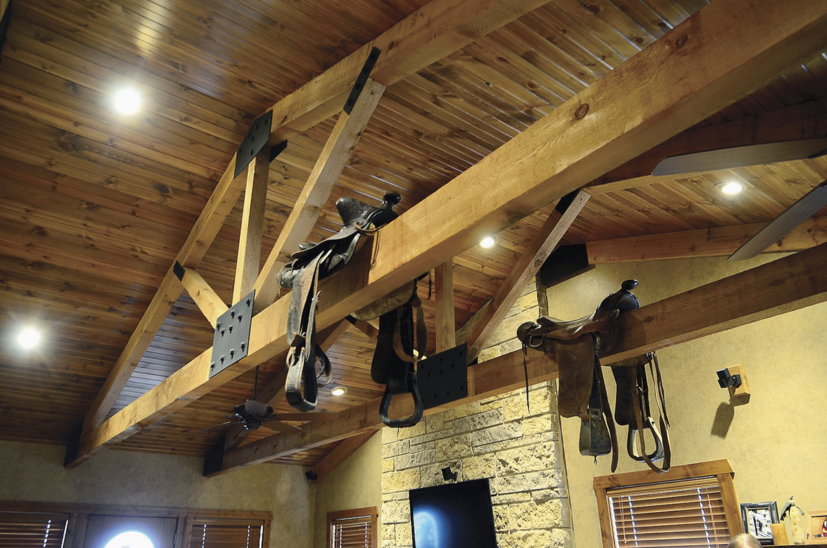 Saddles are seen hanging from rafters in one of the homes owned by former Dixon, Ill., comptroller Rita Crundwell during a to
