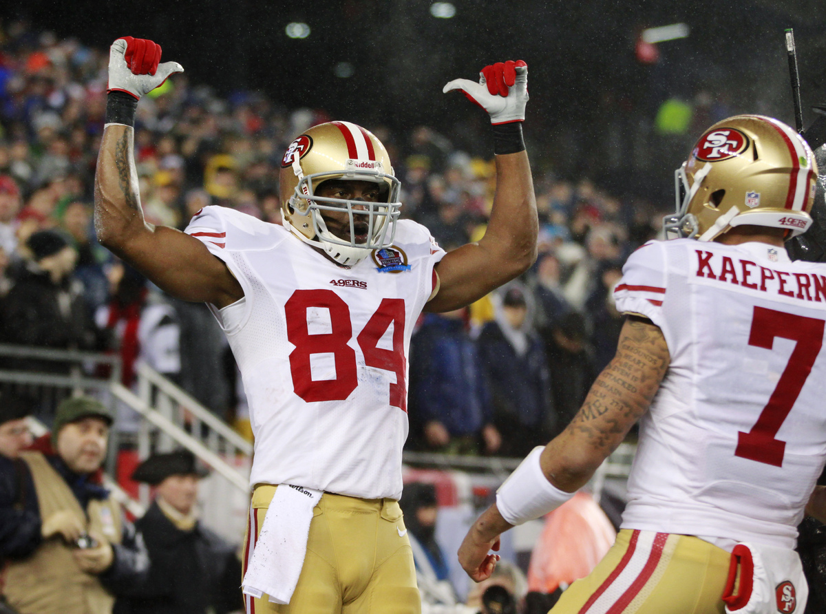 San Francisco 49ers wide receiver Randy Moss (84) celebrates his touchdown catch from quarterback Colin Kaepernick (7) in the