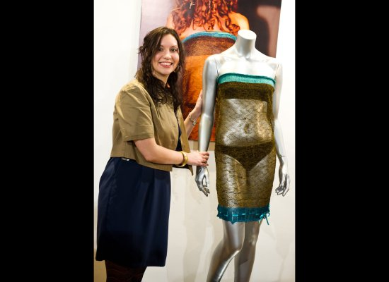 Charlotte Todd stands next to the see through knitted dress she designed which was worn by Kate Middleton at the annual St An