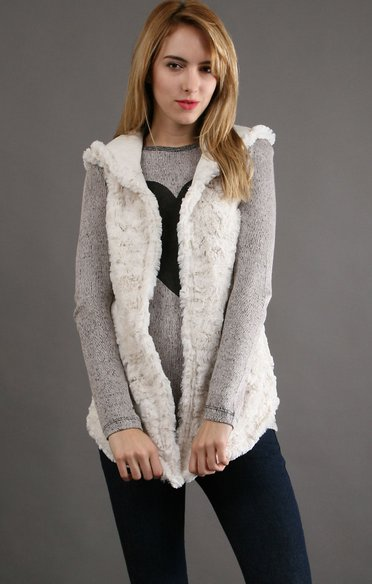 """<a href=""""http://www.couturecandy.com/true-grit/long-hood-vest-in-winter-white-/product.html"""">Couturecandy.com</a>"""