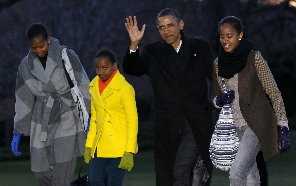 President Barack Obama, first lady Michelle Obama and their daughters Sasha and Malia arrive on the South Lawn of the White H