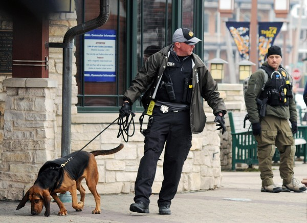 "Police and a K9 officer search the Metra station in downtown Tinley Park, Ill.  (<a href=""http://tinleypark.patch.com/article"