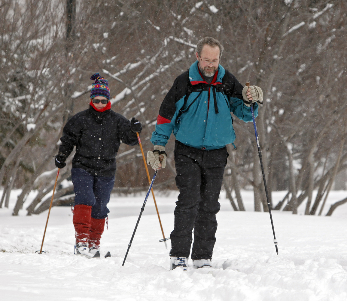 Brian Curtiss and Mary Alyce Owens cross country ski on Friday, Feb. 3, 2012, after a snow storm hit Denver with 10 inches of