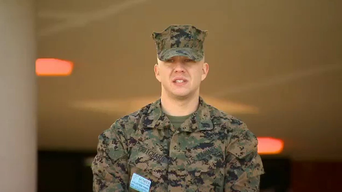 Following the tragic shootings in Newtown Conn., Jordan Pritchard, a former Marine and father of two, decided to stand outsid
