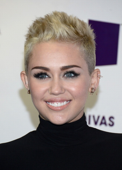"""We're glad Miley found a <a href=""""http://www.huffingtonpost.com/2012/11/20/miley-cyrus-cuts-her-hair-pixie-cut-blonde_n_21644"""