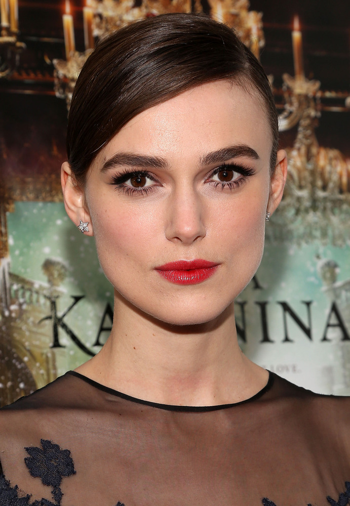 For the girl who can't go anywhere without first applying her favorite red lipstick, take a cue from this actress and pair it