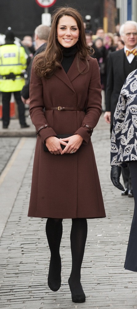 On a charity trip to Liverpool, Kate bundled up in a brown Hobbs coat. It looks chic, sure, but the brown with the plain blac