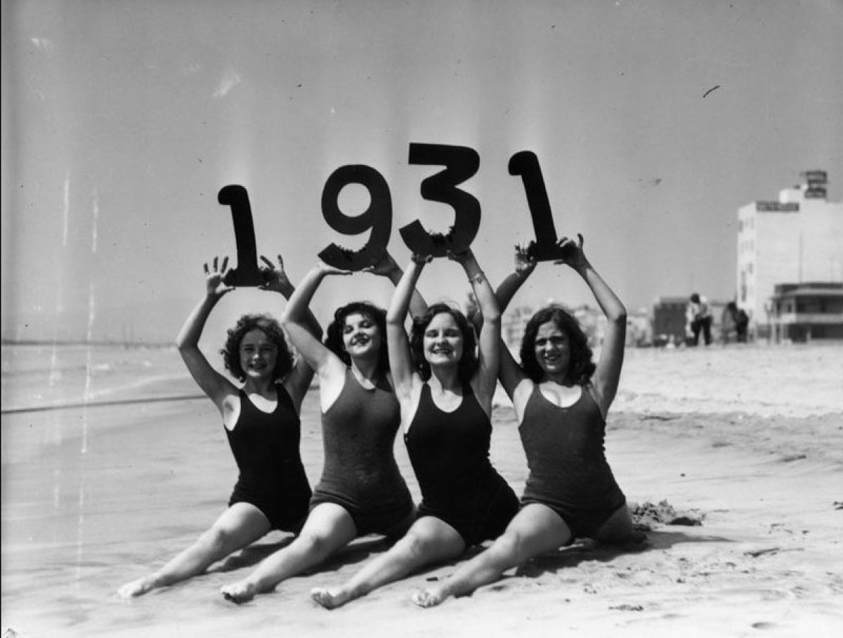 Bathing beauties herald in 1931 by doing the splits in the sand. (Los Angeles Chamber of Commerce Collection, Los Angeles Pub