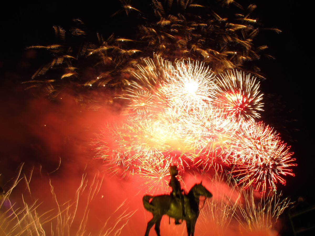 Fireworks go off behind one of Edinburgh's most famous statues, which memorializes a cavalry troop that fought with the Briti