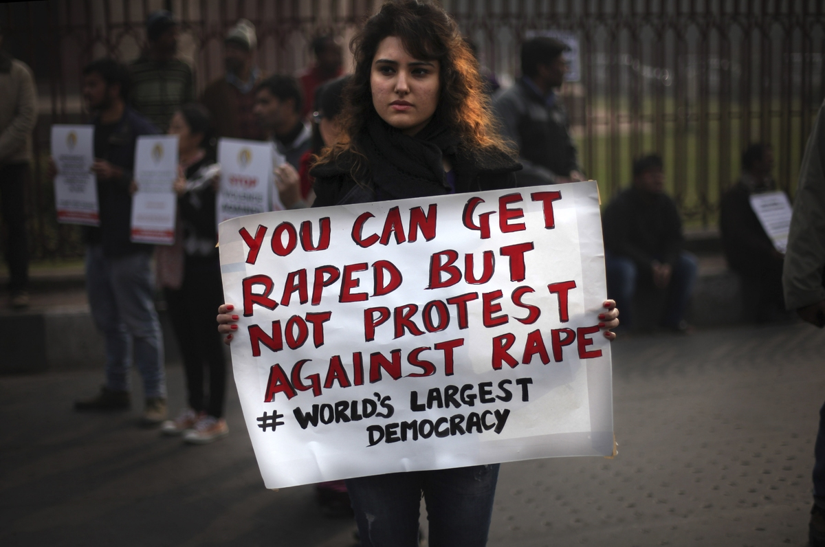 An Indian protester holds a placard during a protest against a recent gang rape of a young woman in a moving bus in New Delhi