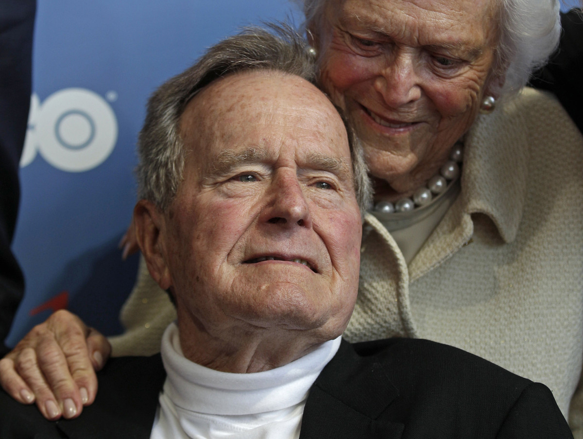 FILE - In this June 12, 2012 file photo, former President George H.W. Bush and his wife, Barbara, arrive for the premiere of