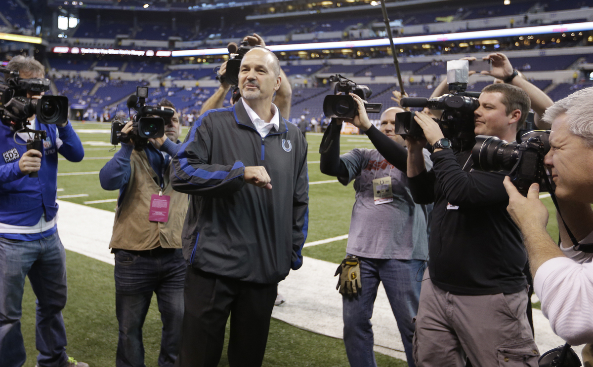 Indianapolis Colts head coach Chuck Pagano acknowledges the fans after walking onto the field before an NFL football game aga