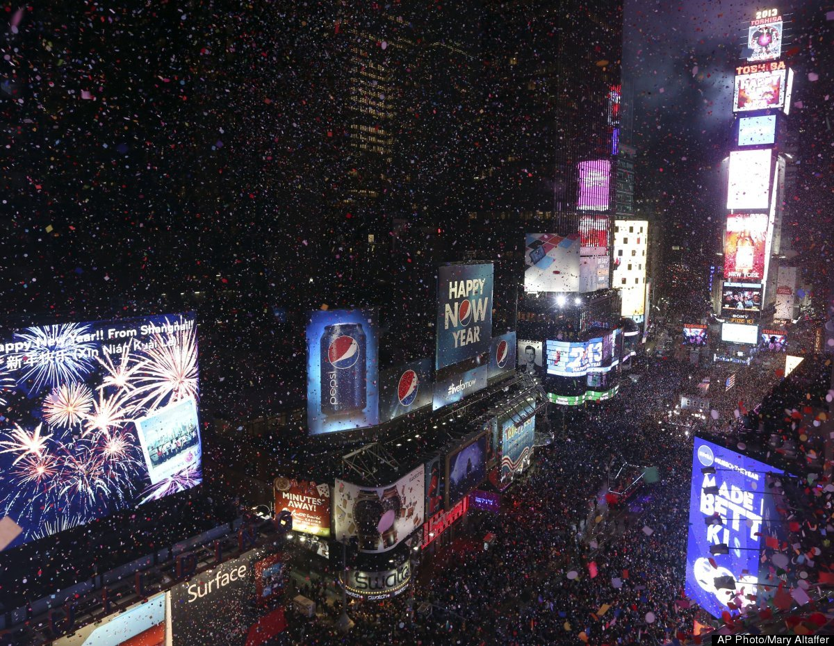 Confetti flies over New York's Times Square after the clock strikes midnight during the New Year's Eve celebration as seen fr