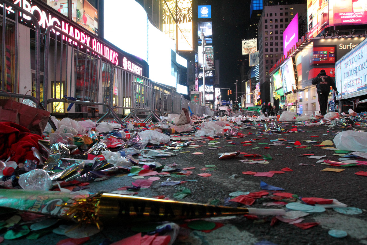 Confetti and other items from the New Year's festivities litters the street in New York's Times Square early Tuesday morning