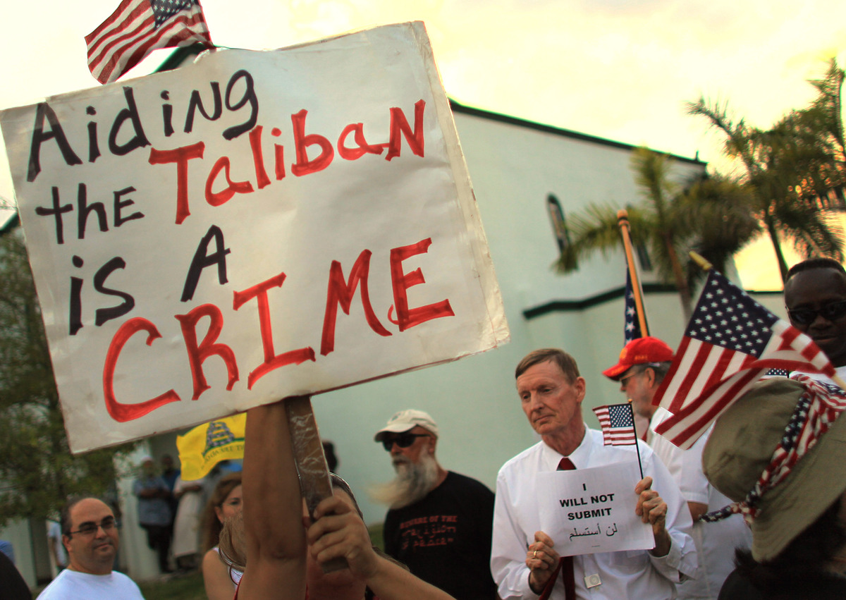 MARGATE, FL - JUNE 07:  Protesters hold signs in front of the Masjid Jamaat Al-Mumineen Mosque as the group attempts to have