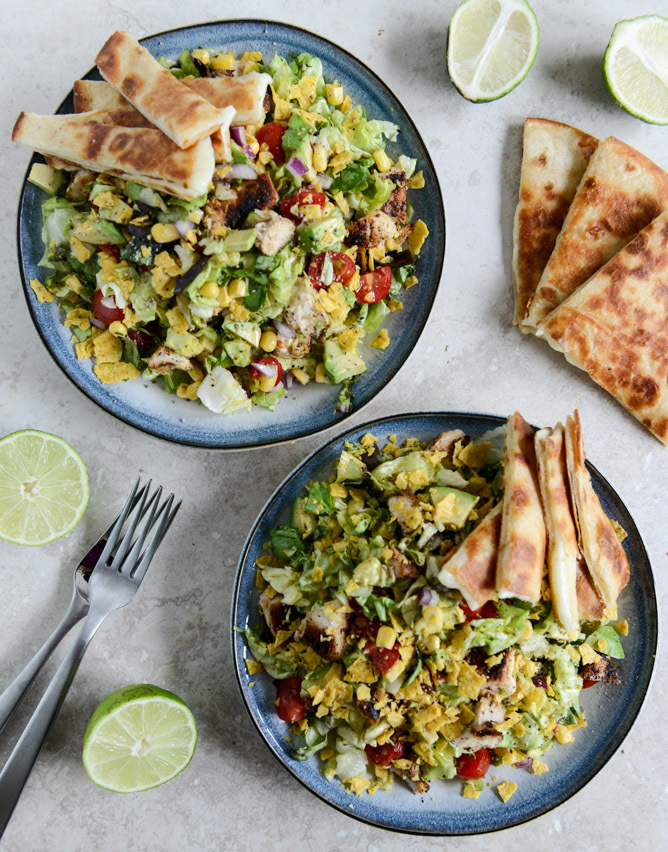 "<strong>Get the <a href=""http://www.howsweeteats.com/2013/06/chopped-chicken-taco-salads-with-cheese-quesadilla-strips/"" targ"