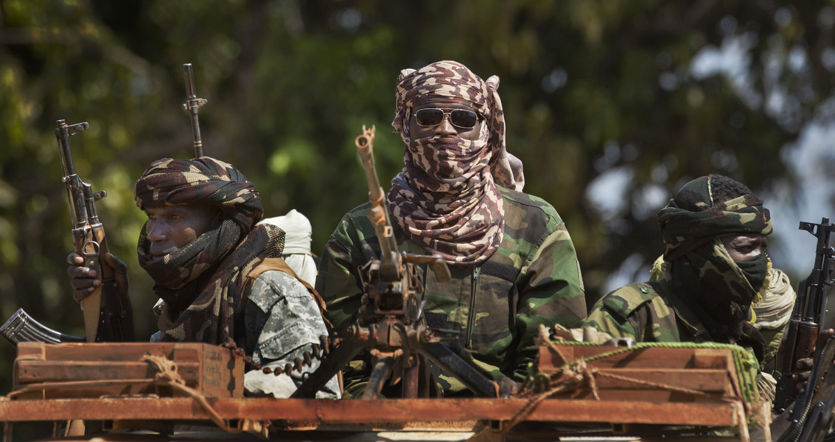 Chadian soldiers who are fighting in support of Central African Republic president Francois Bozize, ride on their trucks in a