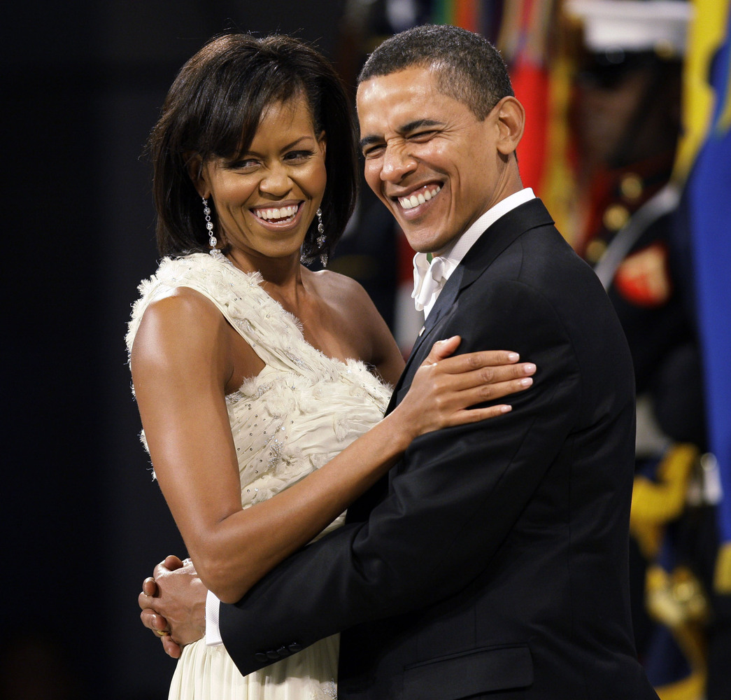 In this Jan. 20, 2009 file photo, President Barack Obama dances with first lady Michelle Obama at the Western Inaugural Ball