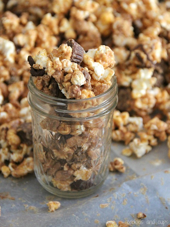 "<strong>Get the <a href=""http://cookiesandcups.com/peant-butter-cup-popcorn-giveaway/"">Peanut Butter Popcorn recipe from Cook"