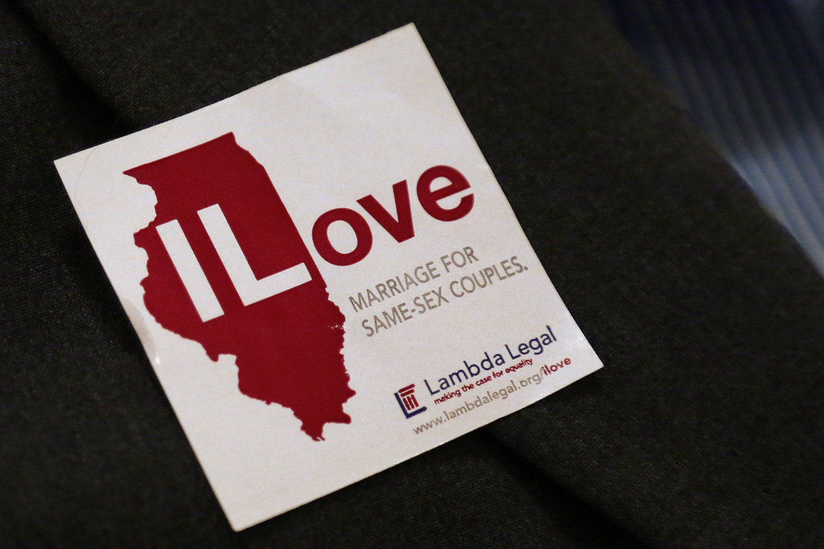 A supporter for same sex marriage wears a sticker on her jacket prior to attending a Senate Executive committee hearing at th