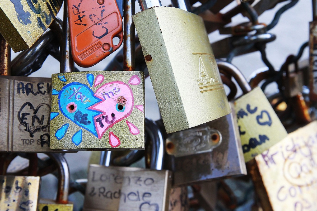 Padlocks adorn the Pont des Arts on January 4, 2013 in Paris, France. The nine-arch metallic footbridge completed in 1804 is