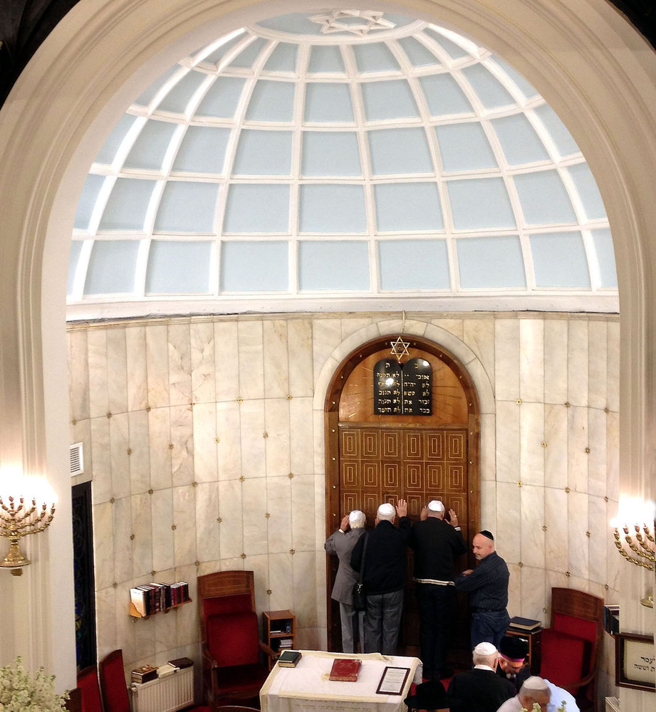After Friday night services at Bet Israel Synagogue in Istanbul, some Jews pray against the Ark doors. The Hahambashi, or chi
