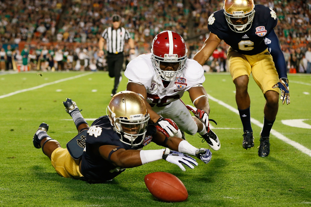 Davonte' Neal #19 of the Notre Dame Fighting Irish fights for a loose ball after muffing the punt against Landon Collins #26